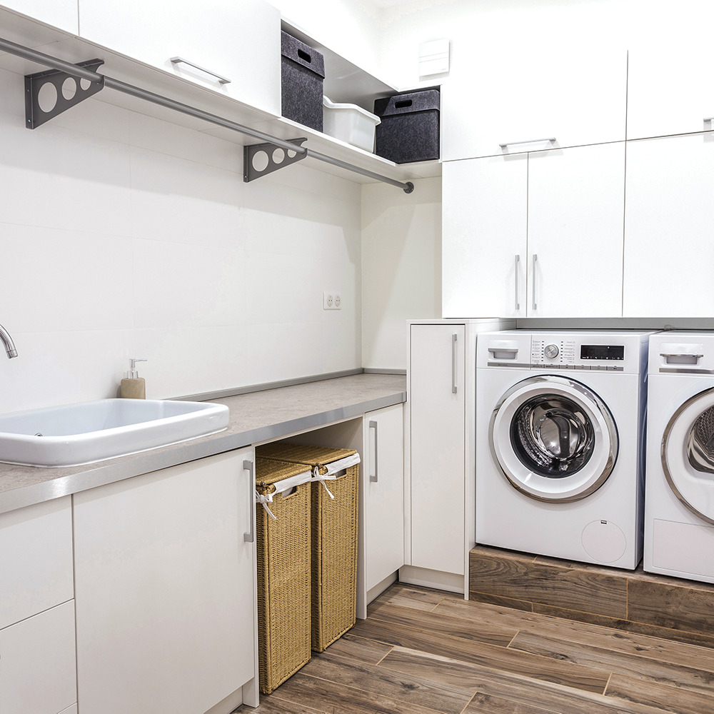 Laundry room with tub, washer and dryer