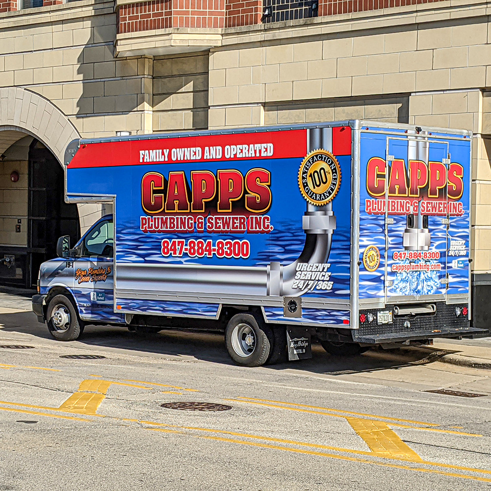 CAPPS Service truck in front of downtown apartment building.